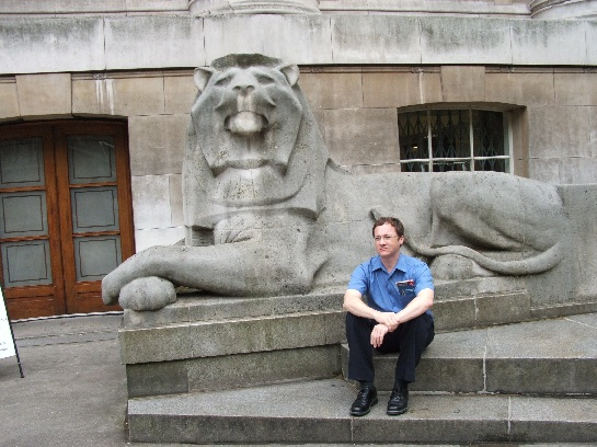 Ross at the foot of the Lions outside the British Museum, London, England