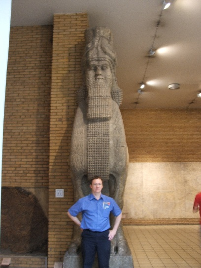 Ross in front of a Babylonian statue at the British Museum, London, England
