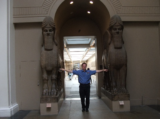 Ross between two Babylonian statues at the British Museum, London, England