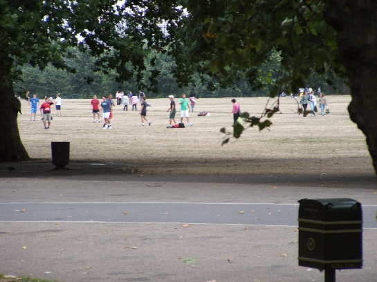 Soccer being played on the bone dry Hyde Park, London, England