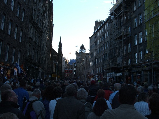 Crowds moving up the Royal Mile to the Edinburgh Military Tattoo parade ground, Edinburgh, Scotland