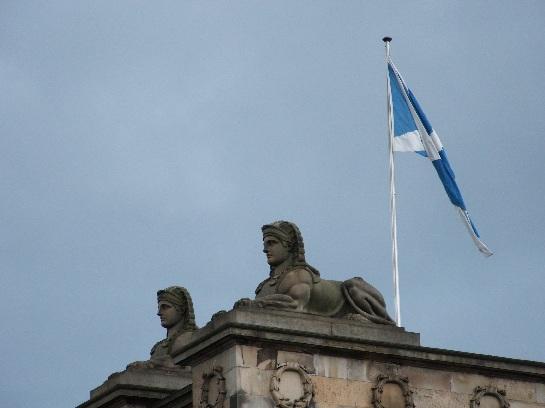 Sphinx on public building with the Scottish Flag, Edinburgh, Scotland