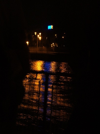 River Cruise at Night (Note blue refelection in water), Blue Danube, Budapest, Hungary