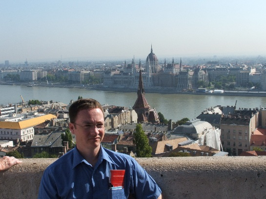 Ross with Budapest Houses of Parliament in the background from Matthias Church, Budapest, Hungary