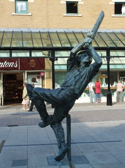 Statue dedicated to Kimmy striding across his cricket stumps, Hastings, England
