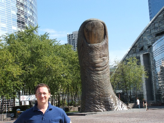 Ross in front of the Thumb Sculpture at La Defence, Paris, France