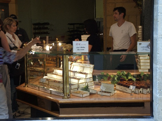 Kim buying cakes at the cake shop in St. Emilion, France