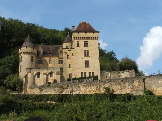 Castle in the Dordogne Valley from the river, France