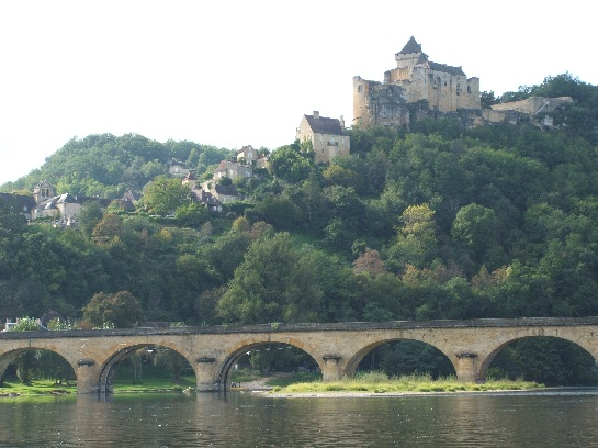 Castle and bridge in the Dordogne Valley from the river, France