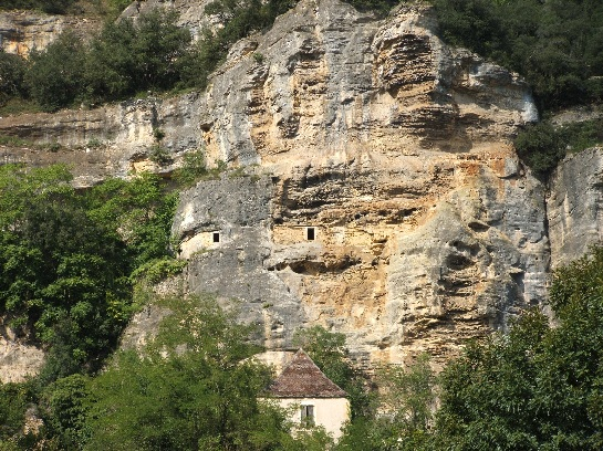 Cliff houses in the Dordogne Valley from the river, France