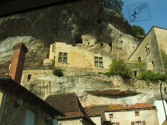 Cliff houses in the Dordogne Valley from the bus, France