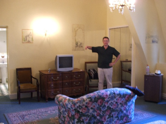 Ross with the ghost in our huge room in the Chateau des Reynats in the Dordogne Valley, France