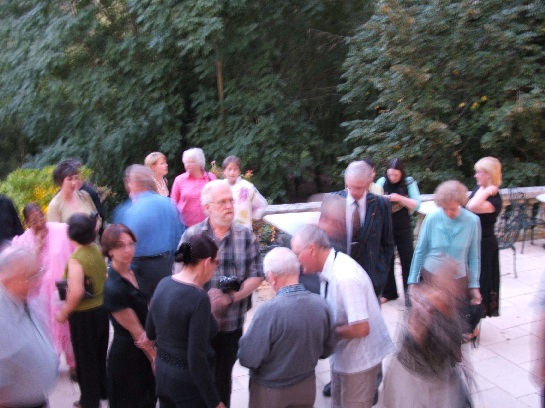 The tour group milling around at the back of the Chateau des Reynats in the Dordogne Valley, France