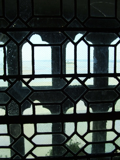 View through the windows of Mont St. Michel looking out to sea, France