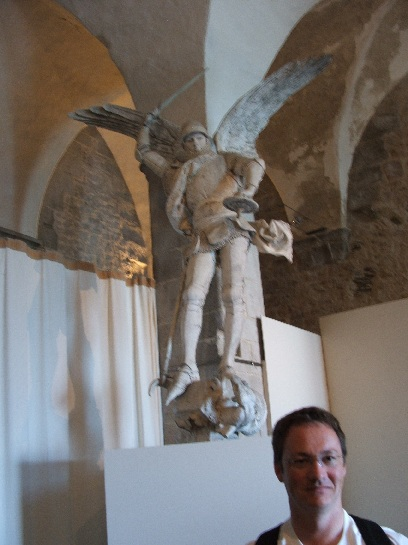 Ross in front of the Statue of Michel inside Mont St. Michel, France