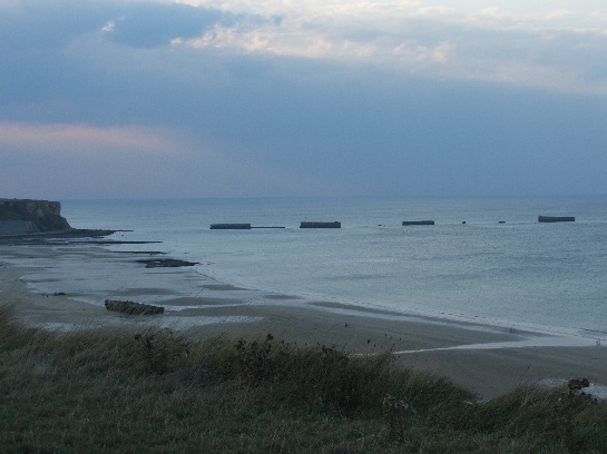 The Mulberry harbours brought as ports from England after the D-Day invasion, Omaha Beach, Normandy, France