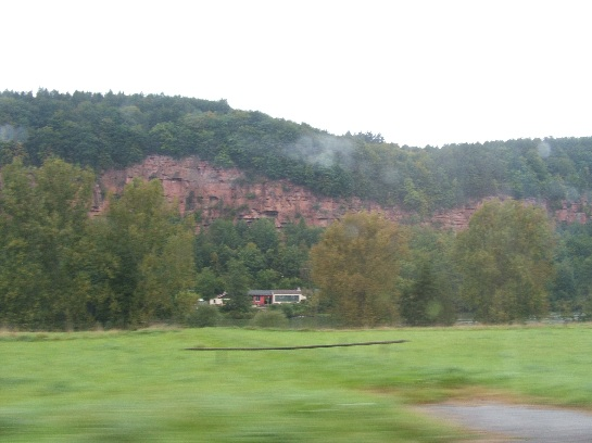 Red sandstone cliffs seen while speeding into the heart of Germany towards Rothenburg, Germany