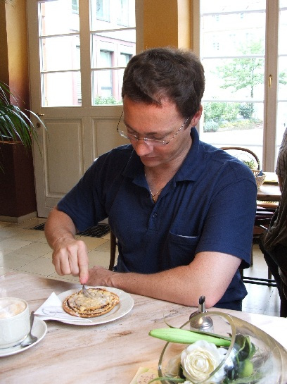 Ross digging into a pastry in Heidelberg, Germany
