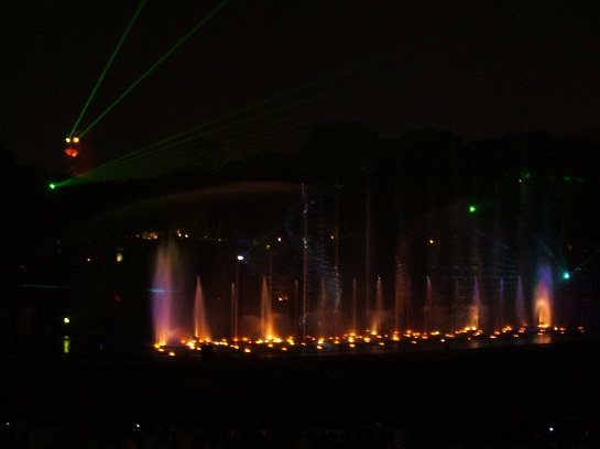 Light show at night using the fountain sprays and laser lights on Sentosa Island, Singapore